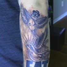 Swallow tattoos done by Robert Jarrett at 2 Ton Tattoo Gallery, Kingsport, TN