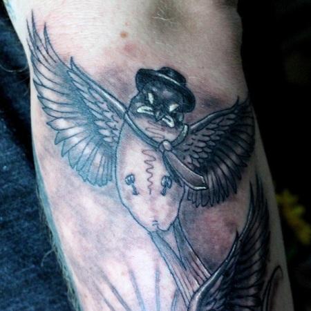 Clown bird - swallow tattoo by Robert Jarrett at 2 Ton Tattoo Gallery, Kingsport, TN