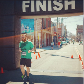 Crossing the finish at the Barley's St. Patrick's Day 5k on March 15, 2015