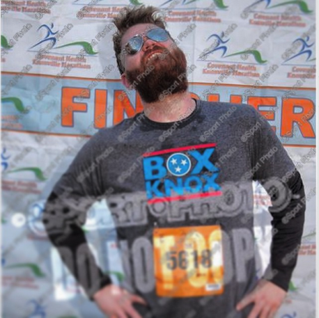 Striking a post after finishing the Covenant Health Knoxville Marathon 5k on March 29, 2015